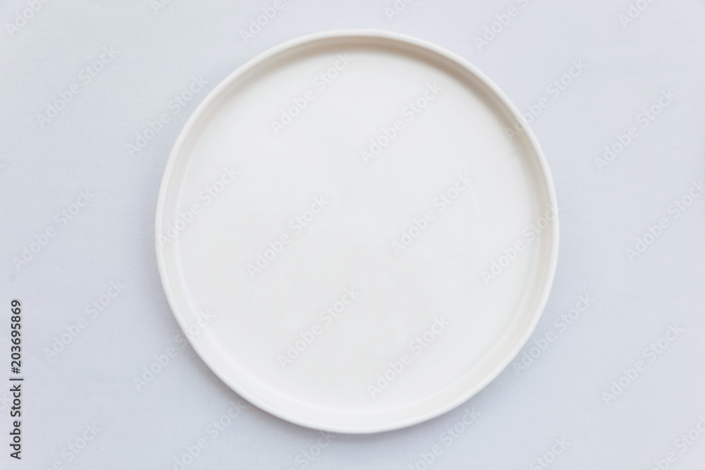Fototapety, obrazy: Top view of white empty plate on white tablecloth.
