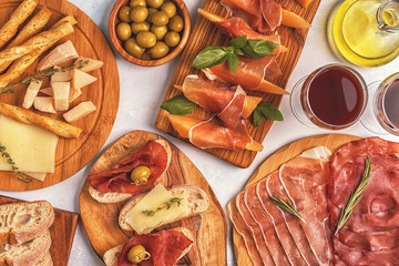 Italian food background with ham, cheese, olives.