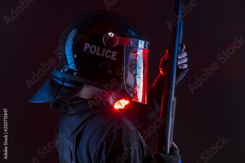 policeman with full equipment for anti-riot, Law enforcer in