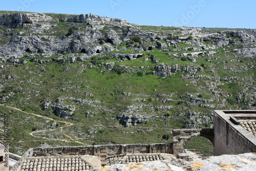 Spoed Foto op Canvas Khaki Italy, Basilicata, Matera, city of stones, Unesco heritage, capital of European culture 2019. Hill with ancient caves in front of the city, on the river gravina