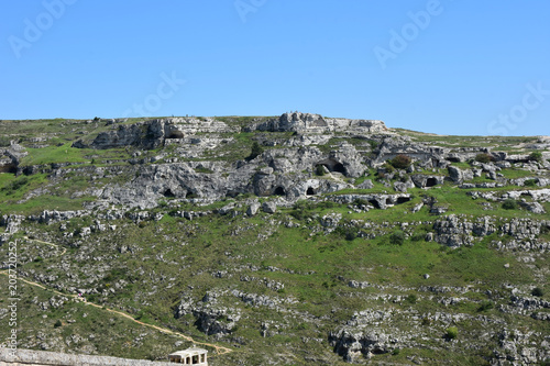 Foto op Plexiglas Khaki Italy, Basilicata, Matera, city of stones, Unesco heritage, capital of European culture 2019. Hill with ancient caves in front of the city, on the river gravina
