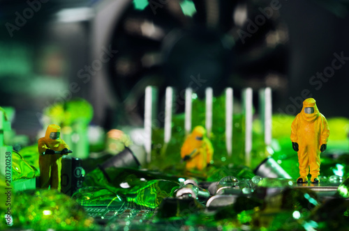 Valokuva  The ecologists or technicians cleaning toxic or radioactive waste on motherboard