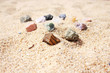 Natural rought gemstones on the sand