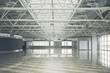 Big bright contemporary empty building with high ceiling reflecting on concrete floor. Design concept