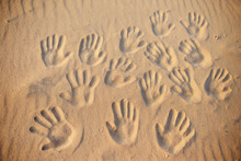 Lots Of Hand Prints On The Sand