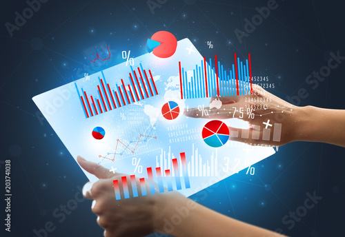 Papiers peints Pays d Afrique Young female hand holding a tablet with red and blue charts