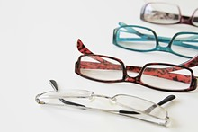 Reading Glasses On A Table Sto...