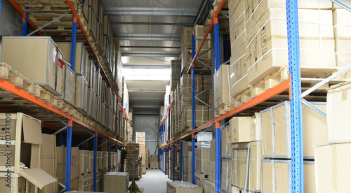 Staande foto Industrial geb. warehouse of industrial goods in boxes on iron shelves for transportation to customers