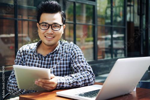 Stampa su Tela Businessman with digital tablet