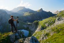 Woman Photographer Looking At Munkebu Mountains In Lofoten