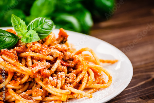 Fotografering Pasta with meat, tomato sauce and vegetables