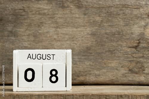 Vászonkép  White block calendar present date 8 and month August on wood background