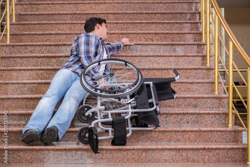 Valokuvatapetti Disabled man on wheelchair having trouble with stairs