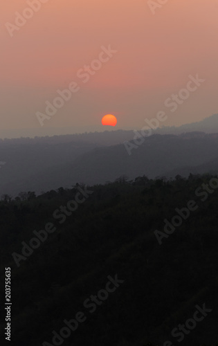 Foto op Aluminium Zalm Sunset sky at the mountain with orange light