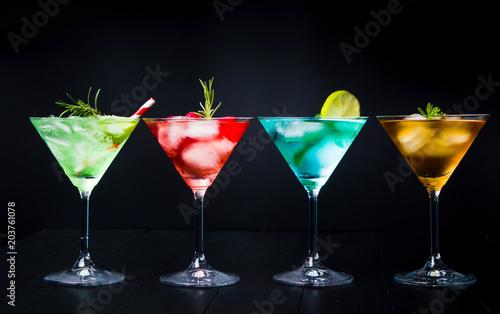 Tuinposter Cocktail Colorful summer cocktails on black background