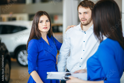 Canvas Prints Textures Beautiful happy couple choosing a new car in showroom