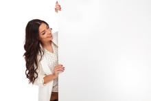 Young And Attractive Businesswoman Reading Board From Side