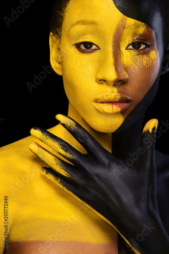 Acrylic Prints Cheerful young african woman with art fashion makeup. An amazing woman with black and yellow paint makeup
