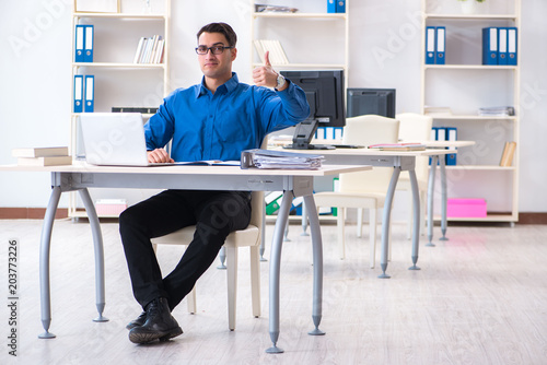 Fototapety, obrazy: Handsome businessman employee sitting at his desk in office