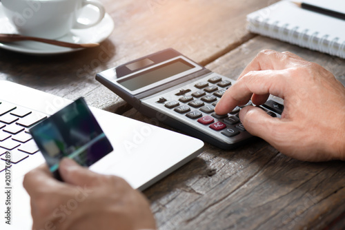 Digital lifestyle concept  Man hands holding credit card and