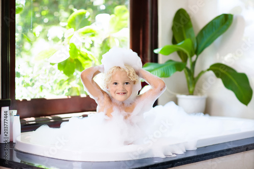 Child in bubble bath. Kid bathing. Baby in shower. - Buy this stock ...