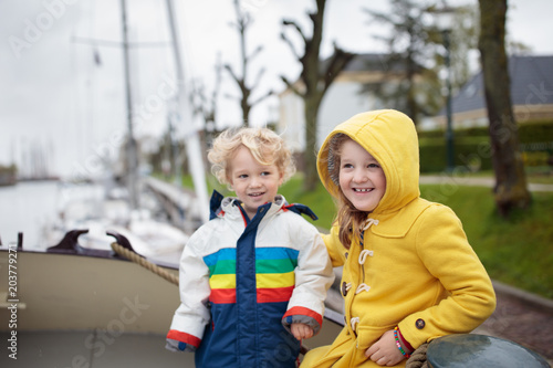 Photo Kids on wooden boat in Holland