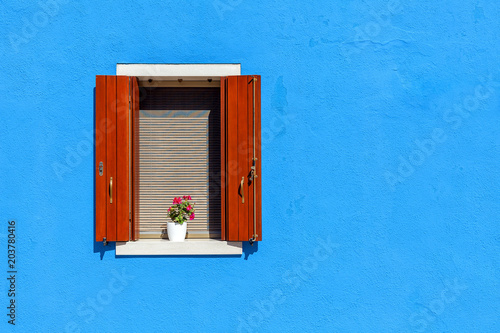 Window on blue wall in Burano, Italy.