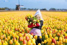 Child In Tulip Flower Field. W...