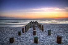 Ruins Of The Old Naples Pier At Sunset On The Ocean