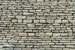 Rough grey stone brick wall
