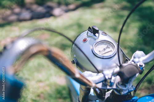 Deurstickers Fiets motorcycle parts headlight with vintage retro motorbike. old timer age concept, 1960s style, outdoor dirt road