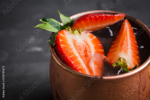 Tuinposter Cocktail Strawberry moscow mule on thr rustic background. Selective focus.