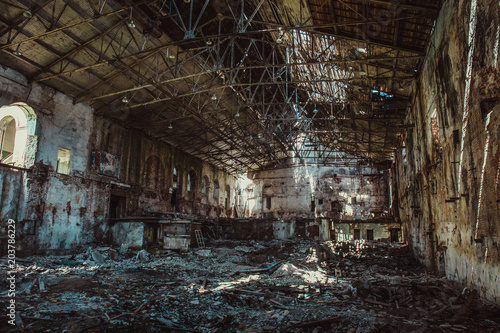 Aluminium Prints Old abandoned buildings Ruins of industrial building interior after disaster or war or earthquake, inside huge warehouse, pills of rubbish