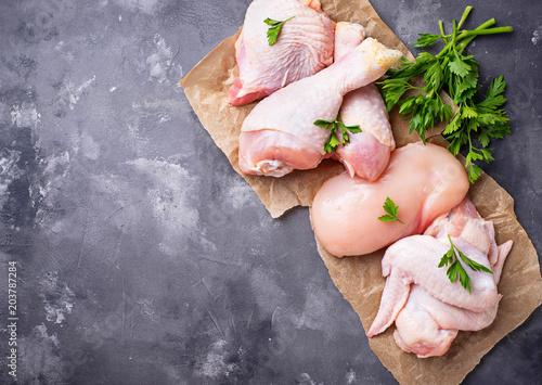 Fotografiet Raw chicken meat fillet, thigh, wings and legs