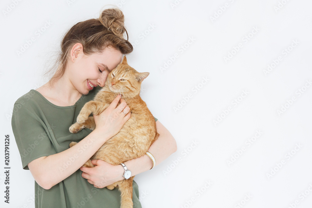 Fototapety, obrazy: Closeup portrait handsome young hipster woman, hugs his good friend ginger cat on white wall background. Positive human emotions, facial expression, feelings. People and animals in love