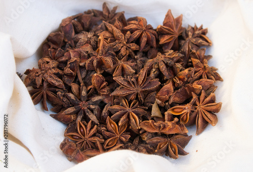 Star anise in a white cloth on display at a market stall Canvas Print