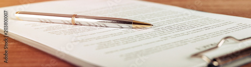 Fototapeta Pen lying on a contract or application form, wide angle view. obraz