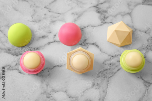 Hygienic lip balms on light background Wallpaper Mural