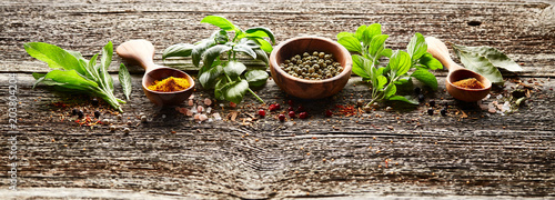 Wall Murals Spices Spices and herbs on wooden board
