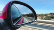 Reflection of the road in cars side rear-view mirror