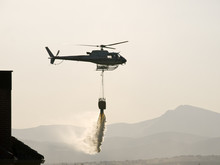 Fire Fighter Helicopter Dropping Water In A Fire