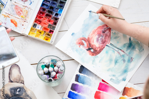 artist instruments and tools for creative leisure. watercolors brushes and color swatches. painting hobby