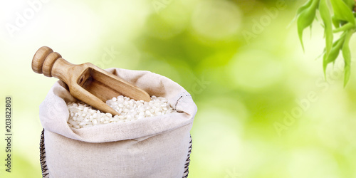 Garden Poster Spa raw rice in the sack with a natural background