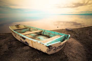 Fototapeta Industrialny abandoned row boat along shore on Salton Sea in the California Desert