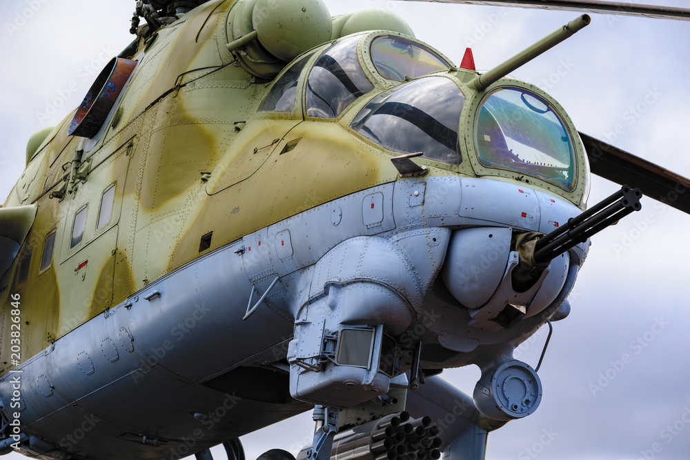 Valokuvatapetti Low angle view to gun, cockpits and part of the fuselage of a Mil Mi-24 (NATO reporting name: Hind) military attack helicopter