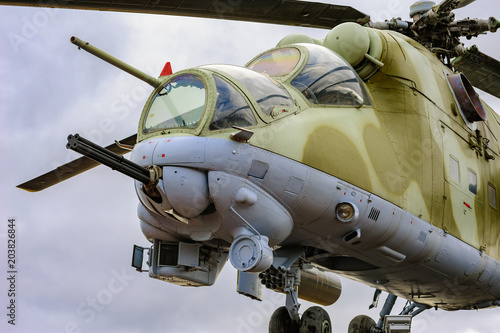 Low angle view to gun, cockpits and part of the fuselage of a Mil Mi-24 (NATO reporting name: Hind) military attack helicopter Canvas-taulu