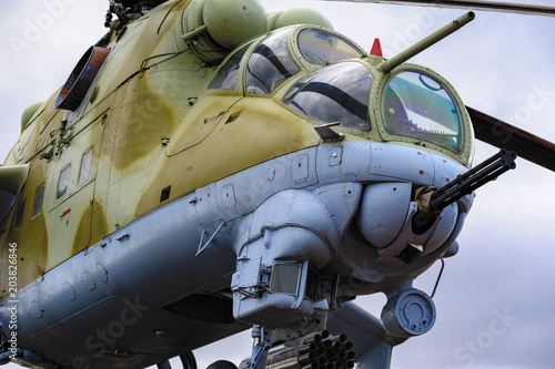 Low angle view to gun, cockpits and part of the fuselage of a Mil Mi-24 (NATO reporting name: Hind) military attack helicopter.