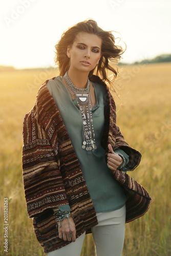 Poster Gypsy girl posing in field