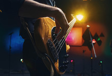 Bass Guitar In The Hands Of A ...