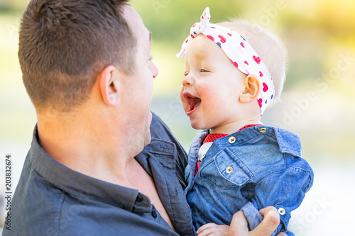 Young Caucasian Father and Baby Girl At The Park Canvas Print